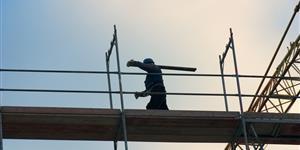 Bild: Bauarbeiter auf Gerüst
