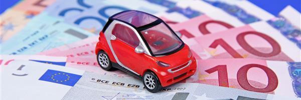 Bild: Modellauto auf Geldscheinen
