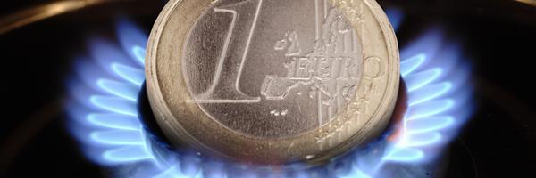 Bild: Münze verbrennt auf Gaskochfeld