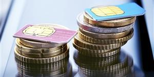 Bild: SIM-Karten auf Geldmünzen